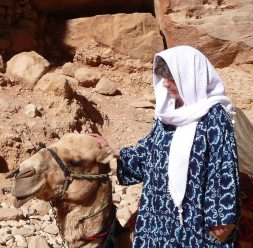 Lovely camel at Petra in Jordon, being petted by Susan